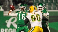 Saskatchewan Roughriders quarterback Brandon Bridge attempts a pass against the Edmonton Eskimos during first half CFL football action at Mosaic Stadium in Regina on Saturday, November 4, 2017. THE CANADIAN PRESS/Mark Taylor