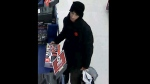 A male suspect wanted for theft and assault is seen in a surveillance camera image. (TPS)