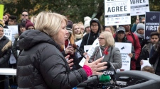 Ontario's Advanced Education Minister Deb Matthews addresses students gathered outside the Ontario Legislature in Toronto on Wednesday November 1, 2017, as they protest against the ongoing strike by Ontario faculty members. THE CANADIAN PRESS/Chris Young
