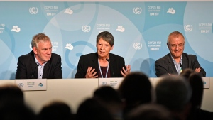 German environment minister Barbara Hendricks, center, talks to the media at the 23rd UN Conference of the Parties (COP) climate talks in Bonn, Germany, Friday, Nov. 17, 2017. (AP Photo/Martin Meissner)
