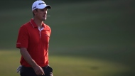 Justin Rose from England walks on the18th fairway during the third round of the DP World Tour Championship golf tournament in Dubai, United Arab Emirates, Saturday, Nov. 18, 2017. (AP Photo/Kamran Jebreili)