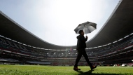 A technician walks on the field at Aztec Stadium as preparations continue for an upcoming NFL football game in Mexico City, Friday, Nov. 17, 2017. The Oakland Raiders face the New England Patriots at Aztec Stadium Nov. 19. (AP Photo/Gregory Bull)