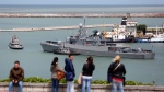Tourists visit the navel base in Mar del Plata, Argentina, Saturday, Nov. 18, 2017. Argentina's Navy said Saturday it was ramping up the search for a submarine that hadn't been heard from in three days. Authorities last had contact with the German-built diesel-electric sub, the ARA San Juan, on Wednesday as it was on a voyage from the extreme southern port of Ushuaia to Mar del Plata. (AP Photo/Vicente Robles)
