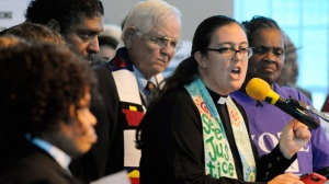 The Rev. Liz Theoharis, co-director of The Poor People's Campaign, speaks at a rally in opposition to Republican U.S. Senate candidate Roy Moore at a church in Birmingham, Ala., on Saturday, Nov. 18, 2017. The demonstration came two days after conservative Christian leaders stood with Moore at another event. (AP Photo/Jay Reeves)