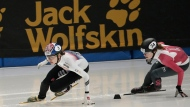 South Korea's Choi Min-jung, left, competes against South Korea's Shim Suk-hee and Canadas' Kim Boutin, right, during the women's 1500 meter final race at the ISU World Cup Short Track Speed Skating competition in Seoul, South Korea, Saturday, Nov. 18, 2017. (AP Photo/Ahn Young-joon)