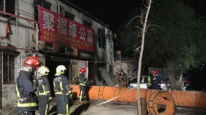 In this photo provided by China's Xinhua News Agency, firefighters work at the site of a fire in Daxing district of Beijing, capital of China, Sunday, Nov. 19, 2017.  The official Chinese news agency says a fire at a building advertising low-cost rental apartments in a southern Beijing suburb has killed more than a dozen of people. (Xinhua/Luo Xiaoguang)