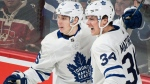 Toronto Maple Leafs' Auston Matthews (34) celebrates with teammate Mitchell Marner after scoring against the Montreal Canadiens during third period NHL hockey action in Montreal, Saturday, November 18, 2017. THE CANADIAN PRESS/Graham Hughes