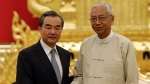 Myanmar's President Htin Kyaw, right, shakes with Chinese Foreign Minister Wang Yi after their meeting at the President House in Naypyitaw, Myanmar, Sunday, Nov. 19, 2017. (AP Photo/Aung Shine Oo)