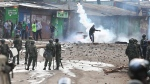 "A supporter of opposition leader Raila Odinga throws back a canister of tear gas towards riot police during running battles with police in Kibera Slums in Nairobi, Kenya, Sunday, Nov. 19, 2017. Kenyan opposition leader Raila Odinga called Sunday for ""international intervention"" in the country's election crisis, saying at least 31 supporters have been killed by police and militia since his return from an overseas trip on Friday. (AP Photo/Brian Inganga)"