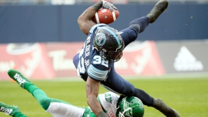 Toronto Argonauts running back James Wilder Jr. (32) is tackled by Saskatchewan Roughriders defensive back Jovon Johnson (1) during second half CFL East Division final football action at BMO Field in Toronto, Sunday, Nov.19, 2017. THE CANADIAN PRESS/Nathan Denette