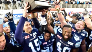 Toronto Argonauts quarterback Ricky Ray (15) hoists the trophy with teammates after beating the Saskatchewan Roughriders in the CFL Eastern final, Sunday, November 19, 2017 in Toronto. THE CANADIAN PRESS/Frank Gunn