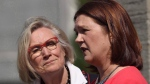 Carolyn Bennett (left), minister of Crown-Indigenous relations and northern affairs looks on as Indigenous Services Minister Jane Philpott speaks to media after a Liberal cabinet shuffle at Rideau Hall in Ottawa on Monday, Aug. 28, 2017. THE CANADIAN PRESS/Sean Kilpatrick