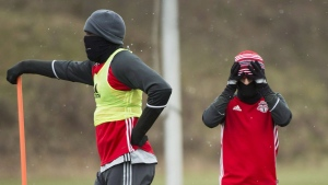 In this file photo, Toronto FC's Jozy Altidore, left, and d Sebastian Giovinco keep warm during practice ahead of the MLS championship final match against the Seattle Sounders in Toronto on Thursday, December 8, 2016. THE CANADIAN PRESS/Nathan Denette