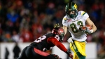Edmonton Eskimos' Brandon Zylstra, right, runs the ball as Calgary Stampeders' Brandon Smith closes in during second half CFL West Final football action in Calgary, Sunday, Nov. 19, 2017.THE CANADIAN PRESS/Jeff McIntosh