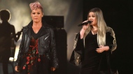 "Pink, left, and Kelly Clarkson perform ""Everybody Hurts"" at the American Music Awards at the Microsoft Theater on Sunday, Nov. 19, 2017, in Los Angeles. (Photo by Matt Sayles/Invision/AP)"