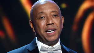 In this Feb. 6, 2015, file photo, hip-hop mogul Russell Simmons presents the Vanguard Award on stage at the 46th NAACP Image Awards in Pasadena, Calif.  (Photo by Chris Pizzello/Invision/AP, File)