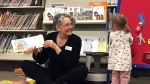 In this April 7, 2017, photo, children's librarian Chere Brown reads to toddlers during a story time at the main Josephine County library branch in Grants Pass, Ore.  (AP Photo/Gillian Flaccus)