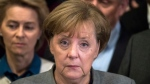 German Chancellor Angela Merkel gives a statement after the pre-talks on forming a new German government failed early Monday, Nov. 20, 2017 in Berlin. (Bernd von Jutrczenka/dpa via AP)