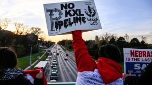 Opponents of the Keystone XL pipeline demonstrate on the Dodge Street pedestrian bridge during rush hour in Omaha, Neb., on Nov. 1, 2017.  THE CANADIAN PRESS/AP, Nati Harnik