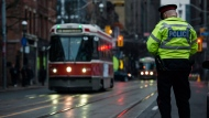 A police constable directs traffic at Jarvis and King St. during the second day of the King Street Transit Pilot on Monday, November 13, 2017. THE CANADIAN PRESS/Christopher Katsarov