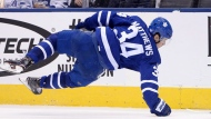 Toronto Maple Leafs centre Auston Matthews (34) loses his stick as he's hit by Arizona Coyotes left wing Anthony Duclair (10) during third period NHL hockey action in Toronto on Monday, November 20, 2017. THE CANADIAN PRESS/Nathan Denette