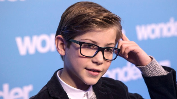 """Jacob Tremblay, star of the movie """"Wonder"""" attends an event at Toronto's Sick Kids Hospital, in Toronto on Monday November 20, 2017. Vancouver child actor Jacob Tremblay was in Toronto on Monday for a special screening of his new film """"Wonder"""" about a child with facial deformities -- sharing it with a group of young patients who live that reality every day and helped him prepare for his role. The 11-year-old plays Auggie Pullman, a child with Treacher Collins syndrome, a rare congenital condition in which babies are born with underdeveloped facial bones and often little or no external ears. THE CANADIAN PRESS/Chris Young"""