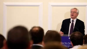 """British Secretary of State for Exiting the European Union David Davis speaks to the ECR """"Deal or No Deal"""" conference in Central Hall Westminster, London, Tuesday Nov. 21, 2017. British media reports say the U.K. is planning to offer more money to settle its """"Brexit bill"""" with the European Union, but only if the EU agrees to start discussing a future free-trade deal. (Philip Toscano/PA via AP)"""
