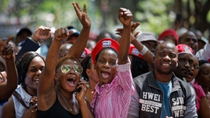 Protesters calling for the impeachment of President Robert Mugabe demonstrate outside the parliament building in downtown Harare, Zimbabwe Tuesday, Nov. 21, 2017. (AP Photo/Ben Curtis)