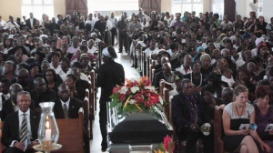 Mourners attend a funeral service for Oscar Bartholomew in Crochu, Grenada, on Jan.9, 2012. The manslaughter case against five Grenada police officers accused of beating a visitor from Canada to death a year ago remains tied up in legal knots. THE CANADIAN PRESS/Colin Perkel