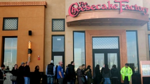 People stand line for the opening of a new Cheesecake Factory restaurant at Yorkdale shopping centre in Toronto on Tuesday Nov. 21, 2017. This is the first Cheesecake Factory location in Canada. THE CANADIAN PRESS/Giordano Ciampini