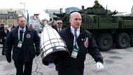 The Grey Cup is carried to the Centre Block as it visits Parliament Hill in Ottawa on Tuesday, Nov. 21, 2017. THE CANADIAN PRESS/Sean Kilpatrick