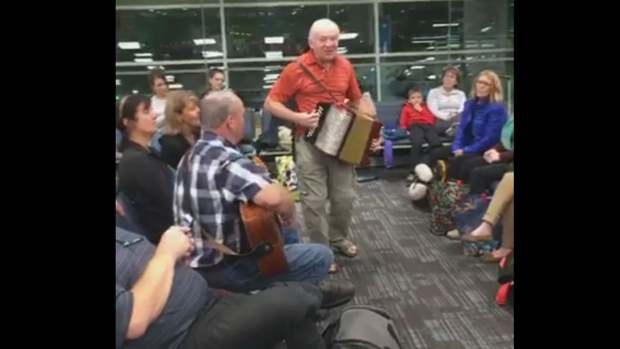 Newfoundland kitchen party breaks out at Toronto airport after flight delayed