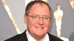 "In this Feb. 28, 2016 file photo, Pixar co-founder and Walt Disney Animation chief John Lasseter arrives at the Oscars in Los Angeles. Lasseter is taking a six-month leave of absence citing ""missteps"" with employees. (Photo by Dan Steinberg/Invision/AP, File)"