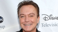 "This Aug. 8, 2009 file photo shows actor-singer David Cassidy arrives at the ABC Disney Summer press tour party in Pasadena, Calif. Cassidy has been hospitalized in Florida. His representative tells The Associated Press on Saturday, Nov. 18, 2017, that Cassidy is ""now conscious"" and ""surrounded by family."" The rep adds that Cassidy was in pain and taken to the hospital on Wednesday. No additional details were provided. (AP Photo/Dan Steinberg, File)"