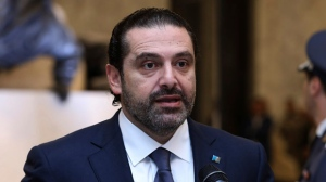 In this photo released by Lebanon's official government photographer Dalati Nohra, Lebanese Prime Minister Saad Harri, reads a statement after his meeting with Lebanese President Michel Aoun, at the presidential palace, in Baabda, east of Beirut, Lebanon, Wednesday, Nov. 22, 2017. Hariri said he will put his resignation on hold to give way for more consultations nearly three weeks after he unexpectedly announced he was stepping down. The stunning reversal was an embarrassment to Saudi Arabia, which was widely seen as having orchestrated his resignation. (Dalati Nohra via AP)