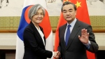 China's Foreign Minister Wang Yi, right, meets South Korean Foreign Minister Kang Kyung-wha at Diaoyutai State Guesthouse in Beijing, Wednesday, Nov. 22, 2017. (Jason Lee/Pool Photo via AP)