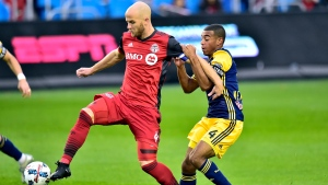 FILE - In this Nov. 5, 2017, file photo, New York Red Bulls midfielder Tyler Adams, right, pulls Toronto FC midfielder Michael Bradley, left, during first-half MLS soccer game action in Toronto.  (Frank Gunn/The Canadian Press via AP, File)