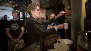 Ontario Premier Kathleen Wynne makes herself a cup of tea at a Toronto coffee shop, before making an announcement regarding the minimum wage in the province, on Thursday, January 30, 2014. THE CANADIAN PRESS/Chris Young