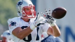 New England Patriots tight end Rob Gronkowski makes a catch during NFL football training camp, Friday, July 28, 2017, in Foxborough, Mass. (AP Photo/Michael Dwyer)