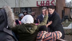 Canadian Prime Minister Justin Trudeau (right) and Toronto Mayor John Tory greets residents after visitng a housing development in Toronto's Lawrence Heights neighbourhood to make a policy announcement , on Wednesday November 22, 2017. THE CANADIAN PRESS/Chris Young