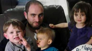 Jeffrey Knowles and his three children are seen in this photo.