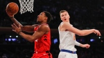 Toronto Raptors guard DeMar DeRozan (10) puts up a shot against New York Knicks forward Kristaps Porzingis (6) during the first quarter of an NBA basketball game, Wednesday, Nov. 22, 2017, in New York. (AP Photo/Julie Jacobson)