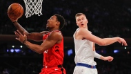 Toronto Raptors guard DeMar DeRozan (10) puts up a shot against New York Knicks forward Kristaps Porzingis (6) during the first quarter of an NBA basketball game, Wednesday, Nov. 22, 2017, in New York. (AP Photo/Julie Jacobson)