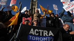 "Ferne Downey, President of ACTRA (centre), heads up the ""OUR TV"" rally on Parliament Hill in Ottawa, Ont., Monday, November 16, 2009. ACTRA and some of Canada's biggest TV stars staged the rally in order to get more Canadian drama back in prime time and to let all of Canada know that the fight is about our culture, our TV and, as Canadians, our voice. The Canadian Press Images PHOTO/ACTRA"