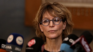 Agnes Callamard, U.N. Special Rapporteur on Extra-Judicial Summary or Arbitrary Executions, talking to reporters in Baghdad, Iraq, Thursday, Nov. 23, 2017. Callamard called on the Iraqi government to speed up investigations into allegations of human rights violations committed by security forces during the fight against the Islamic State group and to make the results of those probes public. (AP Photo/Karim Kadim)