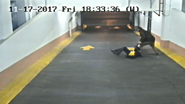 Police have released security camera video of an assault on a 50-year-old woman in a parking garage downtown. (Toronto Police Service handout)