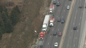 A tow truck driver was injured in a workplace accident on Hwy. 401 in Milton.