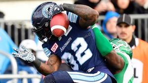 Saskatchewan Roughriders linebacker Samuel Eguavoen (47) wraps up Toronto Argonauts running back James Wilder Jr. (32) during first half action of the CFL Eastern final, Sunday, November 19, 2017 in Toronto. THE CANADIAN PRESS/Frank Gunn