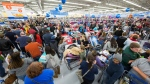 Holiday shoppers scored great deals at Walmart on Thursday, Nov. 23, 2017 in Bentonville, Ark. Color coded departments in Walmart stores helped customers locate top products across categories including electronics, toys, home, and apparel. (Gunnar Rathbun/AP Images for Walmart)