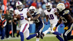 In this Sunday, Nov. 19, 2017, file photo, Buffalo Bills quarterback Tyrod Taylor runs against the Los Angeles Chargers during the second half of an NFL football game in Carson, Calif. The Bills and Chiefs have been riding a similar rollercoaster this season. They both started hot behind great play at quarterback, and they both have stumbled as their QB play has suffered. Throw in similar injuries and you get two teams trying to right their season when they meet Sunday at Arrowhead Stadium.(AP Photo/Jae C. Hong, File)
